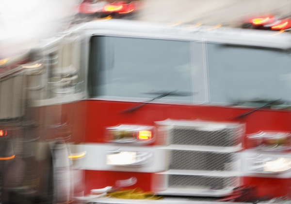 Rural Cozad house fire contained with closed door
