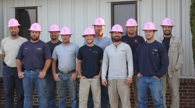 Southern Power District workers proudly wear their pink hard hats