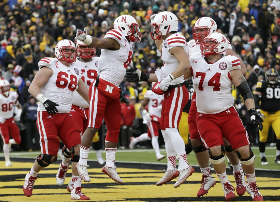 Huskers survive Iowa in OT, 37-34