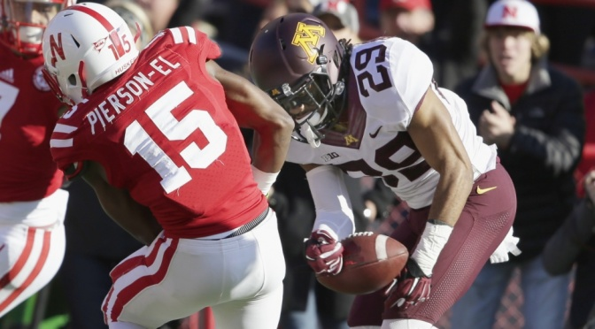 Minnesota defensive back Briean Boddy-Calhoun (29) strips the ball away from Nebraska wide receiver De'Mornay Pierson-El (15) for a turnover in the second half of an NCAA college football game in Lincoln, Neb., Saturday, Nov. 22, 2014. Minnesota won 28-24. (AP Photo/Nati Harnik)