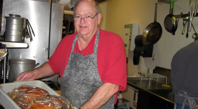 Randy Thruston prepares turkeys for 31st Thanksgiving in the Valley Dinner. (Mo