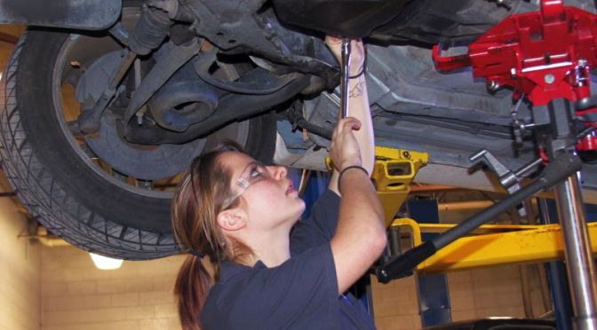 Courtesy/ Mid Plains Community College.  Carra Johnson, of Madrid, works on a car in the automotive technology department at North Platte Community College. She developed an interest for tools and machinery while he