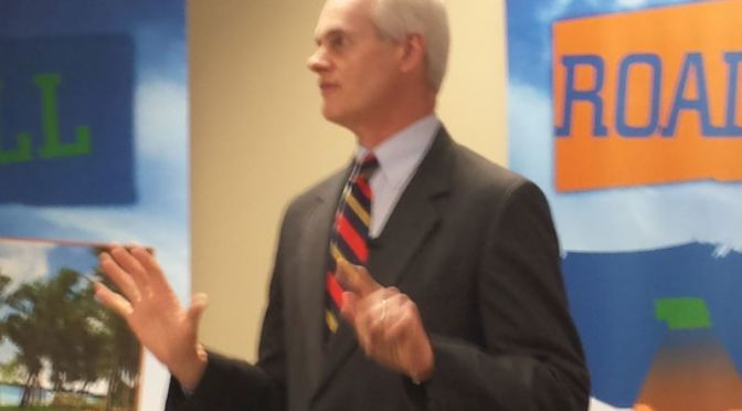 RRN/ Lt. Gov. Mike Foley addresses a roomful of people at t