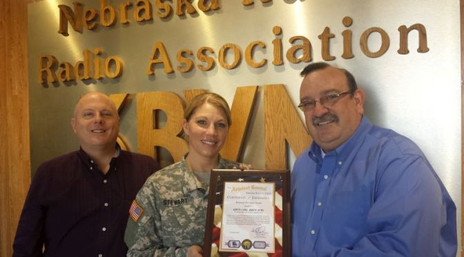 RRN/ Nebraska Army National Guard SFC. Maren Stewart(center) presents Certificate of Excellence to KRVN Radio Station Tim Marshall(right).  Nebraska Broadcasters Association Executive Director Jim Timm(left) also took part in presentation on Wednesday January 28, 2015.