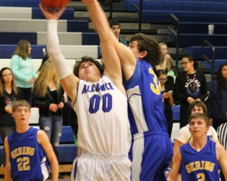 Gering freshman Tyler Pzanka battles Jack Matulka of Alliance for the basketball Friday night(Photo courtesy of Angie Hernandez).
