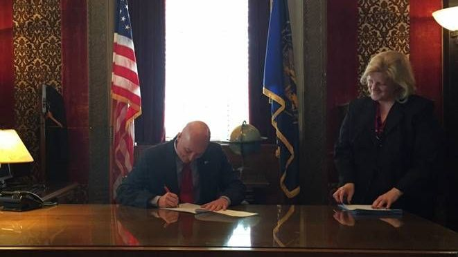 Courtesy/Governor's Office. Gov. Ricketts signing legislation