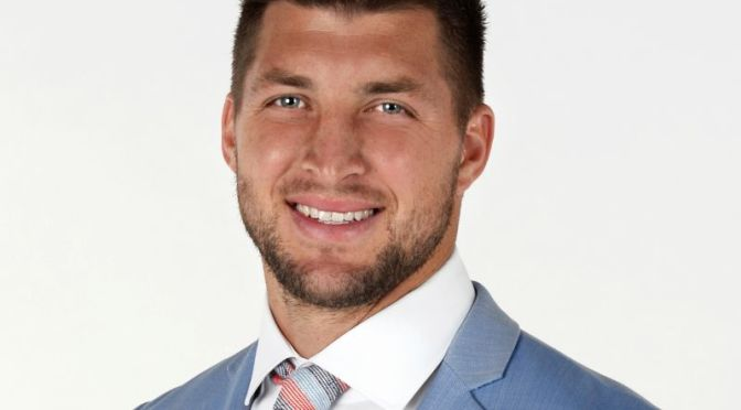 Courtesy/ Photo by Scott Clarke / ESPN Images.  Tim Tebow.