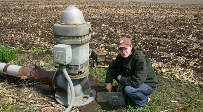 Marie Krausnick, Lead Water Technician of the Upper Big Blue NRD, measures an observation well. (Courtesy photo)