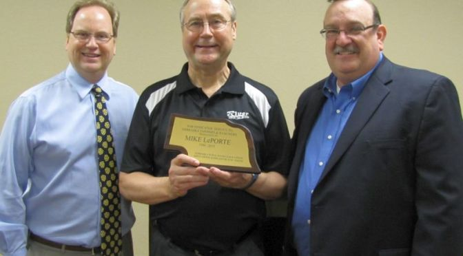 RRN/ KRVN Farm Director Mike LePorte(center) will retire on June 1, 2015.   A reception was held in his honor on May 28, 2015 in Lexington.   Nebraska Rural Radio Association CEO Craig Larson(left) and KRVN Station Manager Tim Marshall(right) present LePorte with a plaque in recognition of his 25 years of service to the NRRA.