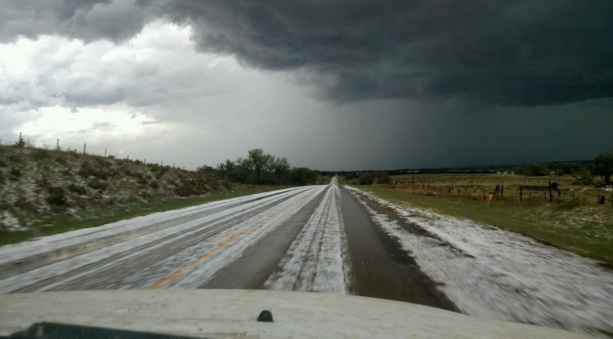 Hail impacted many areas of western Nebraska, eastern Wyoming, and northeastern Colorado, covering the roadway in areas (Courtesy/KNEB Storm Chaser Dan Fitts)