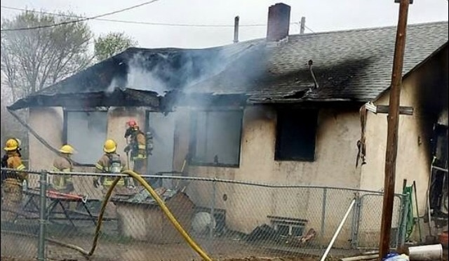 Firefighters work on a fire at a home on L62A Saturday. (Courtesy Photo)