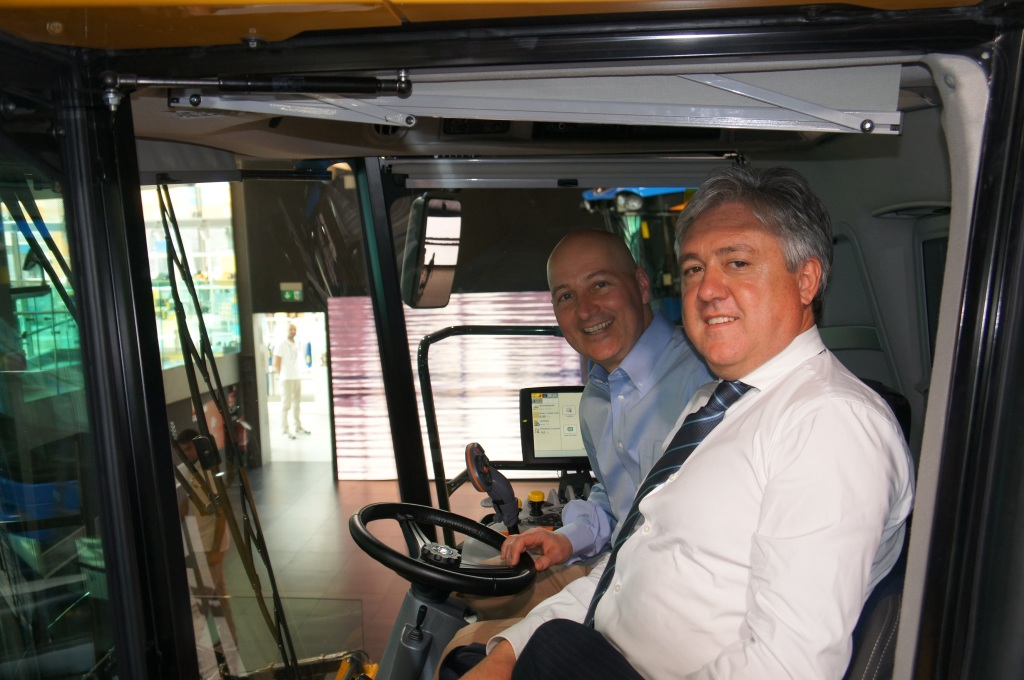 RRN's Jesse Harding. Governor Ricketts with Carlo Lambro, President of New Holland Agricultural in the cab of a tractor.