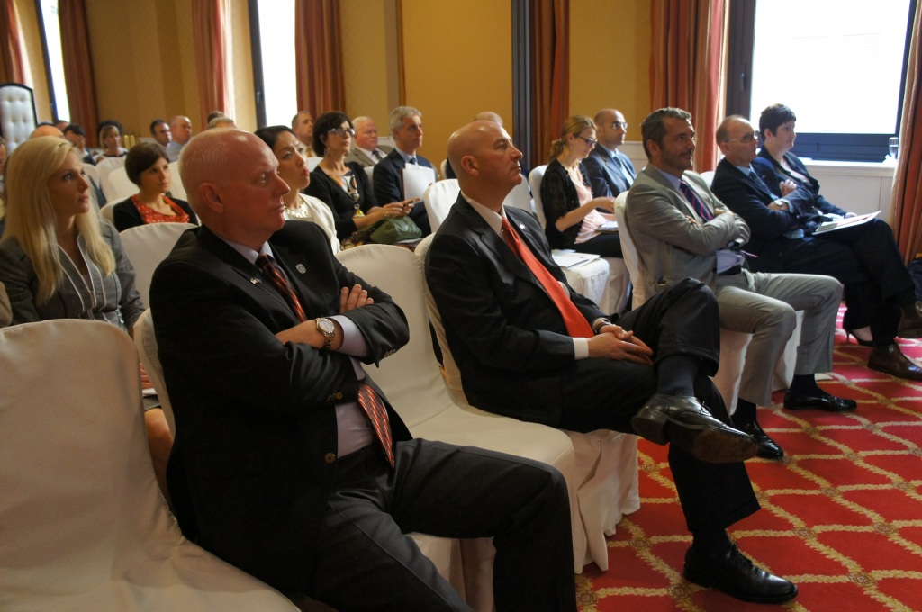 RRN's Jesse Harding. Participants of the Investment Promotion Event listening to a speaker.