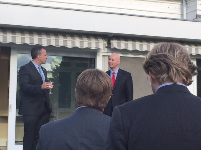 RRN's Jesse Harding. Governor Pete Ricketts along with U.S. Ambassador Gifford talk to the delegation and guests at the Ambassador's residence.