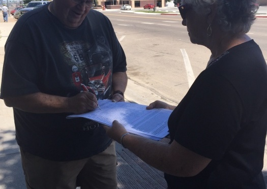 Vivian Tuttle (Right) collects signatures to allow voters to repeal Nebraska's ban of the death penalty