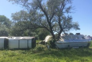 Astray SUV wraps camper around tree