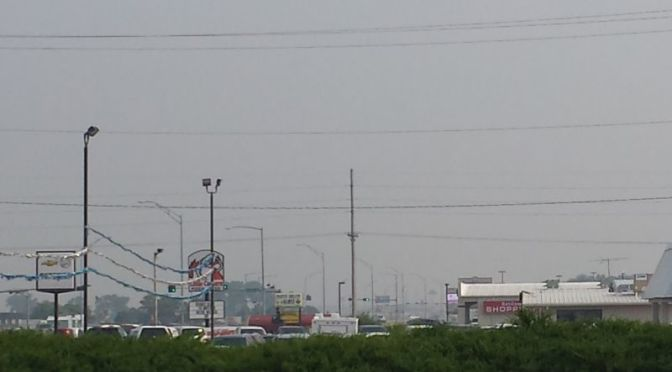 RRN/ A haze and smell of smoke was evident in central Nebraska on Monday July 6, 2015.   This is a view of Plum Creek Parkway business looking south in Lexington.
