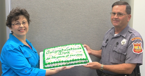Dirk Greene and wife Linda celebrate Greene's retirement at a NGPC southwest division meeting with Greene's co-workers and fellow conservation officers.