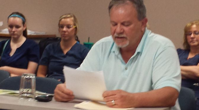 RRN/ General Surgeon Dr. Kerry Buser addresses Lexington Regional Health Center Board of Directors at their meeting July 28, 2015.