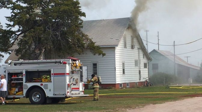 RRN/ Lexington Volunteer Fire Department prepares to attack house fire in Lexington on August 29, 2015.