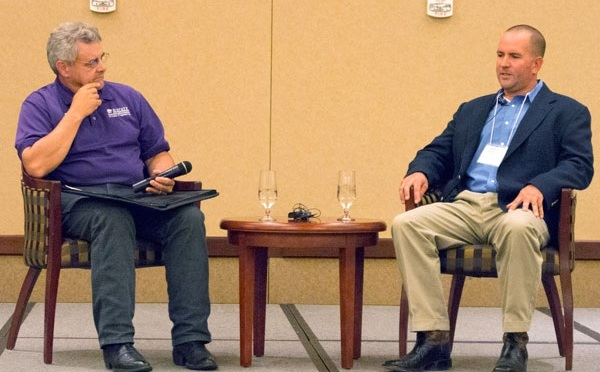 Kansas Wheat Commissioner Jason Ochs (Right) from Syracuse answered questions from Eric Atkinson with the K-State Radio Network and conference attendees on August 20. (Courtesy of Kansas Wheat)