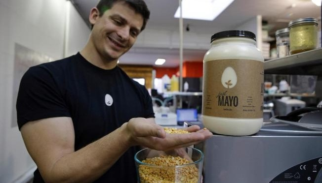 FILE - In this Dec. 3, 2013, file photo, Hampton Creek Foods CEO Josh Tetrick holds a species of yellow pea used to make Just Mayo, a plant-based mayonnaise, in San Francisco. The Agriculture Department say