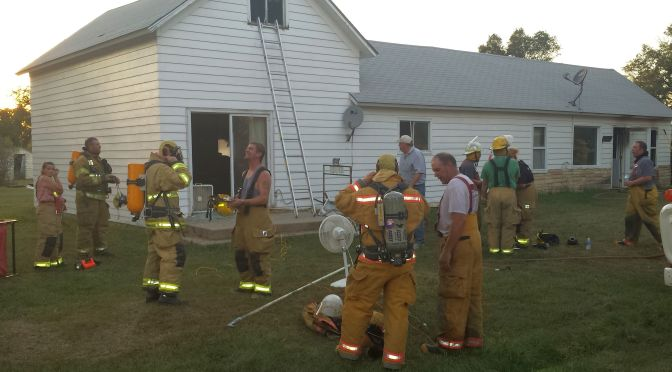 RRN/ Firefighters wind down after extinguishing a house fire in Eddyville Wednesday evening September 2, 2015.   There were no injuries.    Nearby communities of Oconto and Sumner also responded to the scene.