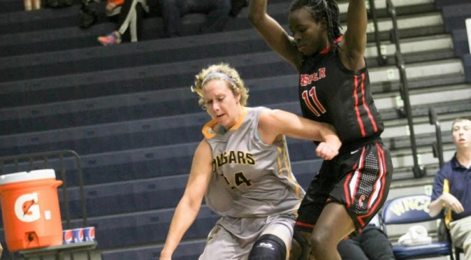 WNCC's Bree Paulson drives to the bucket on Casper's Ruth Hwokora. Casper registered a 70-61 win at Cougar Palace(Photo courtesy of WNCC Media Relations).