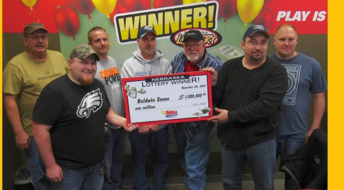 Courtesy/ Nebraska Lottery.  A group of co-workers at Baldwin Filters in Kearney won $1 Million recently playing Mega Millions.