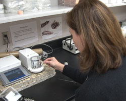 K-State associate professor of geography Kendra McLauchlan runs soil tests in her lab to determine the carbon content.
