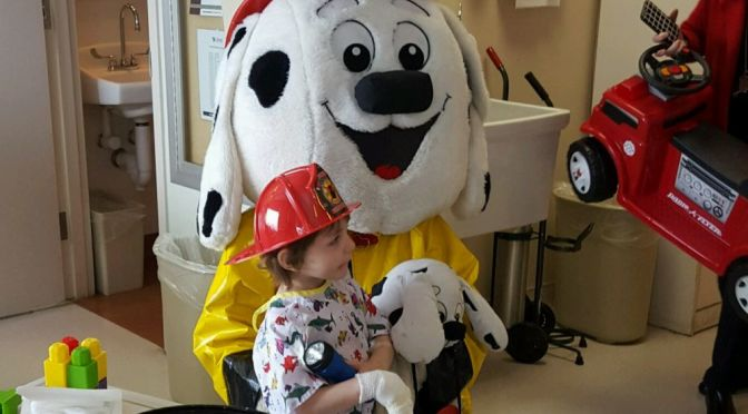 "Courtesy/ Travis Lee.  Cozad Fire and Rescue mascot ""Sparky"" makes a new friend at the Nebraska Medical Center on Friday February 5, 2016."