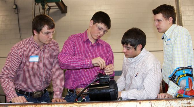 Courtesy/ Mid Plains Community College.  High school students try to rig up a motor Wednesday February 10, 2016 at North Platte Community College. It was all part of a district agricultural education competition.