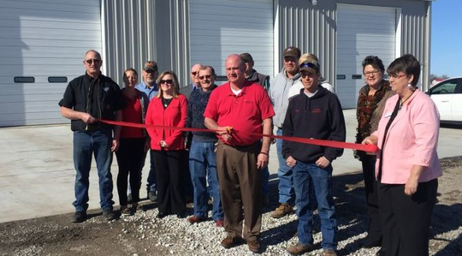 RRN/Custer Public Power District, Rick Nelson cuts the ribbon for the new Callaway Service Center building.