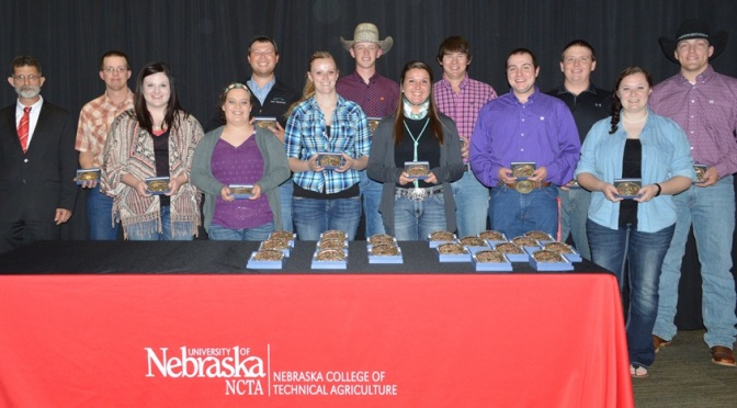 Ron Rosati, dean at the Nebraska College of Technical Agriculture in Curtis, joins some NCTA students who ordered  and received their customized Class of 2016 belt buckles this week. (NCTA Photo)