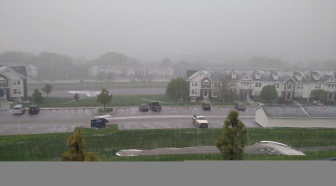 Near 144th and Blondo, hail covered parts of roofs and a pond while heavy rain gushed into manholes.