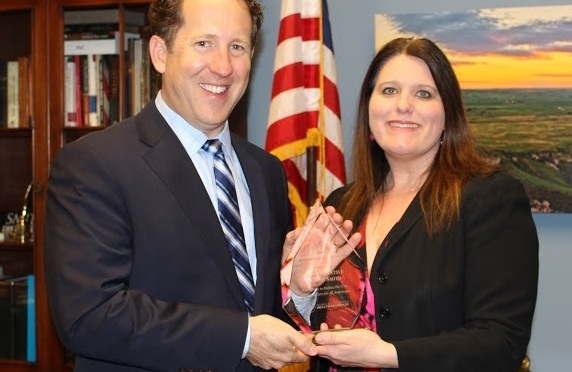 Courtesy/Michelle Stevens, Senior Vice President of the Council for Affordable Health Coverage, presents Congressman Smith with the Affordability Champion Award