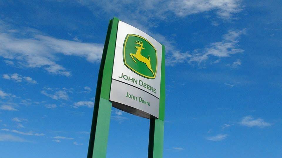 Deere's first-quarter earnings hurt by higher costs, trade war