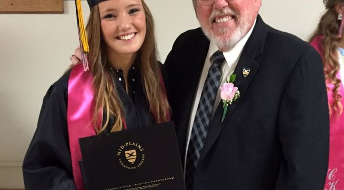 Courtesy/ Mid Plains Community College.  Margaret Rosfeld is the first student to graduate from high school and Mid-Plains Community College at the same time. She's seen here with Chuck Salestrom, MPCC area vice president of public information and marketing, during graduation ceremonies Saturday at Cody-Kilgore High School.