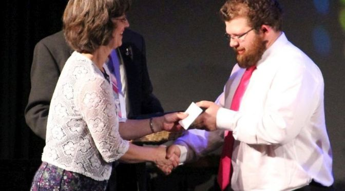Courtesy/ Mid Plains Community College.  Carmen Allen, North Platte Community College music instructor, presents Walker Baird, of Lewellen, with an award during the NPCC Music Department's End of the Year Concert. On Friday, Baird will become one of the first students at NPCC to graduate with an Associate of Fine Arts degree.