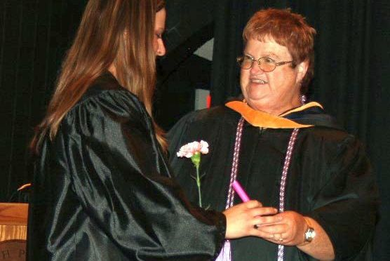 Courtesy/ Mid Plains Community College.  Winnie Dolph congratulates a student during a licensed practical nursing pinning ceremony at NPCC. A memorial scholarship has been created in Dolph's honor.