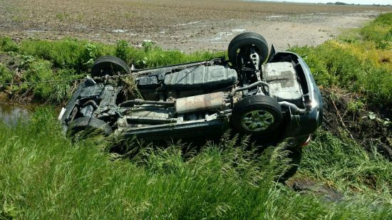 RRN/Vehicle laying in north ditch at the corner of Highway 30 and Road 439.