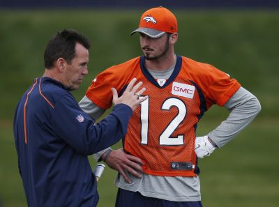 Denver Broncos head coach Gary Kubiak, left, confers with rookie quarterback Paxton Lynch during the team's NFL rookie camp football practice Friday, May 6, 2016, in the team's headquarters in Englewood, Colo. (AP Photo/David Zalubowski)