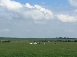Spray plane forced to land in rural Cozad field