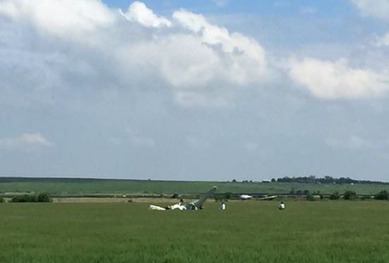 RRN/Spray plane lays upside down in a wheat field north of Cozad after being forced to make a landing.
