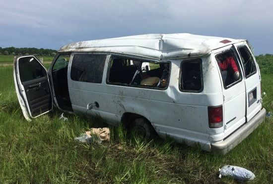 RRN/Van after rolling into north ditch on I-80