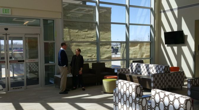 RRN/ Chief Operating Officer Jim Hain and Outpatient Services Center co-director M.J. Hart visit in new entry area of OSC.
