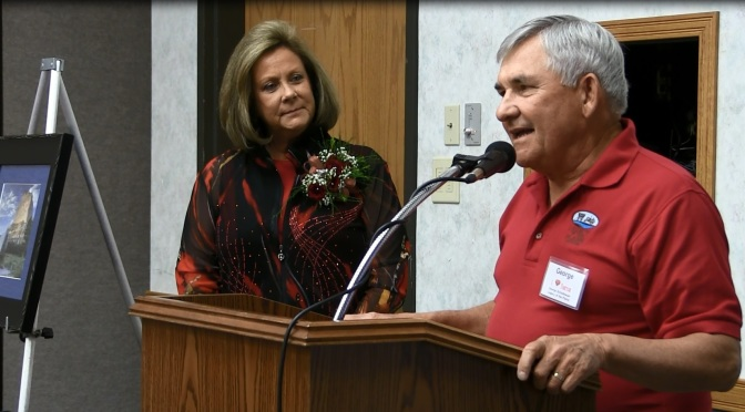 "Gering Convention and Visitors Bureau Director Karla Nieden-Streeks presents the 2016 Tourism ""Buddy Award"" to Dr. George Schlothauer (Mooney/RRN/KNEB)"