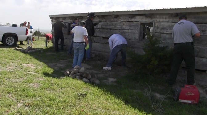 Volunteers working to remove old chinking material at Robidoux Trading Post May 6, 2016.  (Strang/RRN/KNEB)