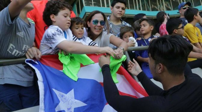 Bryant Velazquez greets some fans before the game with the United State national team on Sunday. Velazquez is playing for the under 20 Puerto Rica national team(Courtesy Photo).
