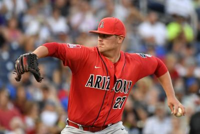 Arizona pitcher JC Cloney throws against Coastal Carolina in the eighth inning in Game 1 of the NCAA Men's College World Series finals baseball game in Omaha, Neb., Monday, June 27, 2016. (AP Photo/Ted Kirk)